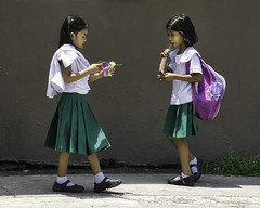 Look (Beegee49) Tags: street children schoolgirls toy drink bacolod city philippines