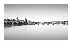 Quintessential (GlennDriver) Tags: black white bw mono monochrome long exposure prague bridge river water architecture buildings europe city charles canon eos nd sky town old