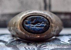 Ancient Roman Glass Ingalio (rustyruth1959) Tags: romanjewellery jewellery old 2ndcenturyad roman signetring romanartefact artefact ancient blueglassintaglio carving intaglio closeup macro blueglass glass silver romanintaglioring ancientromanring silverring ring saturdayselfchallenge ssc home ripponden yorkshire england uk sigma105mmmacro nikond5600 nikon seal