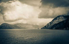 And Like That...You Were Gone (Katrina Wright) Tags: alaskacruise dsc84892 bw ship cruise clouds monochrome mountains nostalgia