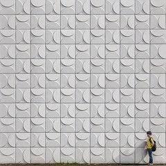 The Magic of Repetition (Paul Brouns) Tags: wall walls square squareformat architecture architectuur architektur almere flevoland white relief abstract boy tiny person scale concrete tiles pattern half moon circle light shadow shadows paulbrouns paulbrounscom