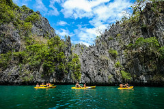 Paddling kayak on blue sea (phuong.sg@gmail.com) Tags: action active activity adventure asia back bay beach behind boat calm canoe caribbean elnido explore extreme floating fun island kayak kayaker kayaking lagoon lake lifestyle mountain nature ocean outdoor paddle palawan people person philippines recreation sea sport summer tourism travel tropical vacation vietnam wanderlust water woman young