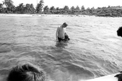 073170 36 (ndpa / s. lundeen, archivist) Tags: nick dewolf nickdewolf july blackwhite photographbynickdewolf bw 1970 1970s monochrome blackandwhite film mexico mexican yucatán yucatan yucatanpeninsula islamujeres island caribbean water swim swimming swimmer ocean sea man nd shore beach watersedge child girl mask swimmers nicole fatheranddaughter snorkeling snorkel shallows shallowwater palmtrees