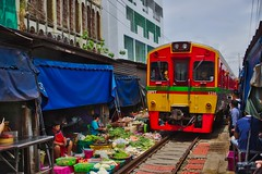 Mae Klong railway market with passing train in Samut Songkhram province in Thailand (UweBKK (α 77 on )) Tags: mae klong railway market amphawa samut songkhram train track goods food sell sale southeast asia sony alpha 77 slt dslr
