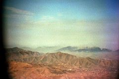 Landing in Lima, Peru (//sarah) Tags: red blue sky plane mountains desert lima peru grain film minoltasrt100