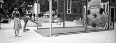 Ngee Ann City Event (JamCanSing) Tags: hasselblad xpan panoramic pano street blackandwhite bnw xtol