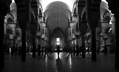 (cherco) Tags: woman mujer arquitectura architecture light lineas composition composicion canon chica cordoba mosque mezquita blackandwhite lonely luz alone vanishingpoint city ciudad canoneos5diii floor reflejos arch arco archs monochrome markiii spain