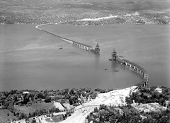 Everyone's talking about the old Tappan Zee bridge being demolished, but here's a view from 1954 of its construction. Note the white swaths of cleared land where the New York State Thruway would eventually be built. (wavz13) Tags: newyorkphotographs newyorkphotos westchestercounty rocklandcounty newyorkthruway newyorkthroughway newyorkstatethruway newyorkphoto newyorkphotography highwayphotography bridgephotography highwayphotos bridgephotos construction constructionsites bridgeconstruction newyorkbridges hudsonriverbridges infrastructure highways oldbridges vintagebridges modernbridges newbridges freeways hudsonvalley hudsonriver oldtappanzeebridge oldphotographs oldphotos 1950sphotographs 1950sphotos oldphotography 1950sphotography oldhighways vintagehighways oldroads vintageroads vintagephotographs vintagephotos vintagephotography filmphotos filmphotography oldnewyorkphotography oldnewyorkphotos vintagenewyorkphotography vintagenewyorkphotographs vintagenewyorkphotos vintageconstruction oldconstruction oldnewyorkbridges