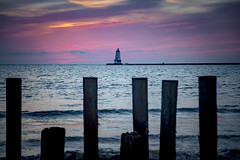 Ludington (Notkalvin) Tags: ludington michigan lighthouse northbreakwallsunset notkalvin mikekline notkalvinphotography posts sunset lakemichigan clouds colorful nopeoplemoutdoors navigation light