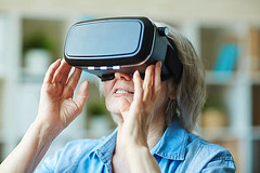 Senior female in vr headset - Credit to https://www.lyncconf.com/ (nodstrum) Tags: technology tech game gaming virtualreality reality augmentedreality oculusrift oculus future headset industry immersive