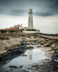 St Mary's Lighthouse (david.travis) Tags: lighthouse northumberland england cloud reflection rock weather unitedkingdom stmaryslighthouse coast sea clouds coastline seashore