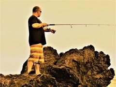 Fisherman (thomasgorman1) Tags: canon man rocks ledge lavarock beach fishing fisherman candid recreation hawaii island punuluu reel rod