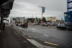 Time to See a Flim (Jocey K) Tags: newzealand nikond750 christchurch cbd building architecture trees people street road rainning flags cars carpark mural streetart artwork sky