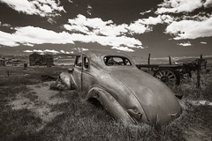Bodie Revisited (CameraOne) Tags: bodieghosttown california owensvalley clouds relic antique blackandwhite monochrome sepia polarizer cameraone canon6d raw canonef1740mm wideangle outdoor rust 1930s statepark historic arresteddecay urbandecay