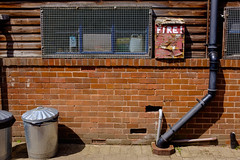 Let Me Stand Next To Your Fire (Michael Goldrei (microsketch)) Tags: 2018 discard spring england discarded street drain hathersage photos summer photographer st photography fuji junk drains jul series brick metal photo drainpipes wall box debris x wooden juli european fire wood burnt xseries drainpipe fujifilm litter trash abfall fujilovers julu x100t 18 waste rubbish garbage reject refuse europe bins uk