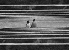 stairway (heinzkren) Tags: schwarzweis blackandwhite bw sw monochrome panasonic lumix people paar lines linien spiegelung candid couple grafenegg street streetphotography stairs tribüne stufen