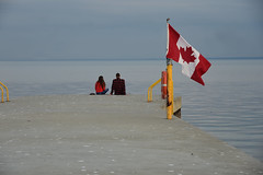 Canada Day (remiklitsch) Tags: oakville ontario lake pier flag red white remiklitsch nikon july1 canada couple evening mapleleaf canadaday