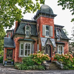 Brockville Ontario - Canada - Second Empire Architecture - Heritage  House (Onasill ~ Bill Badzo - 54M View - Thank You) Tags: brockville ontario on ont canada 181 king street st e east hwy 2 kinghwy waterfront lakeontario heritage historic historical house mansion victorian second empire architecture style mansard roof fish scale shingles flowers portico door shutters tower john gill smart manufacturing co mfg renovated broome mayor onasill canon eos rebel sl1 18250mm sigma macro lens telephoto 19250mm grenvillecounty leedscounty
