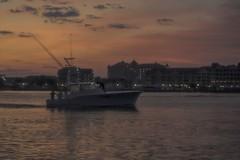 Enchanted Voyage (delmarvajim) Tags: digitalart digitalprocessing digitaleffects fineart bay boat sunrise dawn fantasy architecture darklight reflection water clouds city