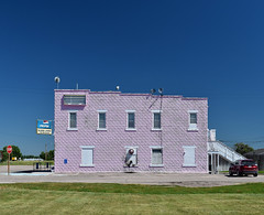 Pink Palace (Patinagal) Tags: facade building relic architecture windows mainstreet peelingpaint faded