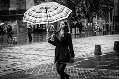 Brolly Dolly (Cycling-Road-Hog) Tags: blackwhite candid canoneos750d citylife colour efs1855mmf3556isstm edinburgh headphones mobile monochrome music people places royalmile scotland street streetphotography streetportrait style umbrella urban woman