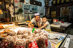 Father & son (Phg Voyager) Tags: father son leica mp 24mm summilux shop china xian smile happy color street urban night light phgvoyager meat butcher muslim oldcity streetfood photography humanity