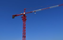 A crane at construction site (phuong.sg@gmail.com) Tags: abstract against background block blue building business city construct construction crane dark design development engineering equipment estate foundation frame heavy high highrise hoist industrial industry lift lifting machine mechanical metal metallic modern new project silhouette site sky steel structure sun tall tower urban work
