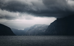 In Light and Darkness (Ornaim) Tags: lysefjord fjord norway moody dark weather mountain sea water boat songesand rogaland norge norvege ryfylke blue nikon d850 tamron lee filter gnd 03 grad hard landscape nature