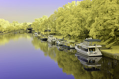 Docked on the Erie Canal (blue plus infrared) (dr_marvel) Tags: ir evening trees yellow blue waterway erie eriecanal port docked infrared pittsford rochester reflections