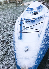 Snow-covered kayak (vastateparksstaff) Tags: cold snow winter kayak grass mountains outdoors water