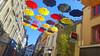 Cherbourg (Rose Wilhelmina) Tags: umbrella lights sun lumière sky city ville colors couleurs parapluie parapluies blue