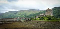 Eilean Donan (Chilanga Cement) Tags: castle eileandonan highlander clouds stone water loch kyle mountain fuji fujix100f fujifilm