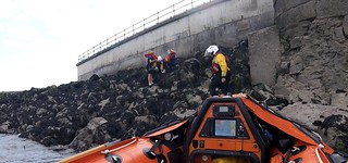 Porthcawl RNLI rescue two girls cut off by the tide near the entrance to Porthcawl Marina
