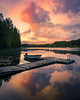 Reflection (andreassofus) Tags: nature landscape clouds sky thunder thunderstorm water lake reflections mirror summer summertime evening sunset sun sunlight light color colorful trees jetty boat tranquility relax beautifulevening sweden outdoor nopeople horizon