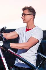 Sport Ideas and Concepts. Caucasian Male Athlete in Good Fit Together With Mountain Bike. Lifting The Bike Up. (DmitryMorgan) Tags: 1 20s sportsandfitness active adult athlete attractive beautiful bicycle bicyclist bike boy caucasian cheerful countryside cycle cyclinggloves cyclist exercise explorer glasses goodfit guy handsome holding lifestyle male man mountainbike nature one outdoors outside people protective ride riding safety sport sportive summer sunset travellers trip twenties