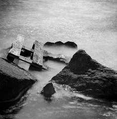 Floating.. (Karl Johan) Tags: fujineopanacros fuji neopan acros 6x6 analog epsonv600 epson v600 ishootfilm limhamn skåne sweden sverige malmö hasselblad 500cm mf mediumformat outdoor film blackandwhite blackwhite rodinal bw bwfp monochrome classicblackwhite splanar12056 splanar 12056 120 longexposure ocean sea stones