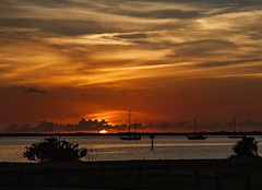 Got a late start this morning and almost missed it (mimsjodi) Tags: sunrise sky clouds water indianriverlagoon sailboats boats dawn