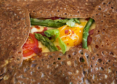 Close-up of a Breton buckwheat galette filled with fresh vegetables, cheese, and an egg for lunch in Paris, France (thstrand) Tags: redgreenyellowbrowncolors buckwheatflour breton bretoncrepes brittany browncolor brunch buckwheat cafe cafes closeup colorful cookery cooking copyspace crepe creperie crepes cuisine culturaldish culture dailylife delicious dish dishes egg eggyoke eggs europe european food foodandnutrition france french galette galettebretonne galettesdeblenoir ingredients lemaraisdistrict lunch macro meal meals nobody nutrition pancake pancakes paris preparedfoods regionalfoods restaurant restaurants savory selectivefocus square table thinpancake tourism touristattraction traveldestination traveldestinations vegetable vegetables