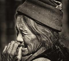Pensive (bag_lady) Tags: portrait monochrome pensive tibet tingri village thoughtful villager remote
