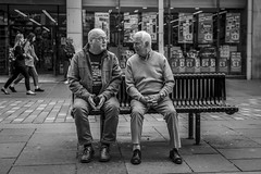 A Meeting of Minds (Leanne Boulton) Tags: urban street candid portrait streetphotography candidstreetphotography streetlife sociallandscape old elderly man men male faces face expression gesture hands sitting bench conversation interaction talking communication bodylanguage tone texture detail depthoffield bokeh naturallight outdoor light shade city scene human life living humanity society culture lifestyle people canon canon5d 5dmkiii 50mm ef2470mmf28liiusm black white blackwhite bw mono blackandwhite monochrome glasgow scotland uk