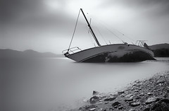 Shipwreck (Bo.Th) Tags: shipwreck water waves sky seaside sea seascape silence beach boat clouds coast calm forgotten abandoned landscape greece dreaming monochrome