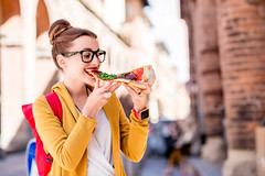 bigstock-143282450-1024x683 (yaminraj) Tags: woman italy student food snack break pizza eating people city urban italian bologna europe old historical adult university campus person girl caucasian casual young female colorful glasses yellow sweater one arches arcade archway classic arch traditional slice summer outdoor eat lunch