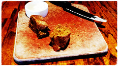 Breaking Bread (Adventurer Dustin Holmes) Tags: bread food brown outbacksteakhouse springfieldmo dining springfieldmissouri