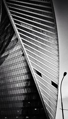 #Moscow City street light (NO PHOTOGRAPHER) Tags: hochhaus gebäude cityscape skyline detail construction blackandwhite monochrome architecture architectural urban building outdoor iphoneography iphonephotography exterier russia moscowcity technoart sky clouds moscowphotography blue light shade dark shadow city geometric lookingup window skycraper iphone 6s p aboutlove analogy freestyle fineart blackandwhitephoto monocromephotography bnw bw hochhauspanorama panoramatic 7 москва россия архитектура строительство река мост photography mobile mobilephotography square