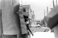 073670 16 (ndpa / s. lundeen, archivist) Tags: nick dewolf nickdewolf july blackwhite photographbynickdewolf bw 1970 1970s monochrome blackandwhite film mexico mexican yucatán yucatan yucatanpeninsula caribbean islamujeres island people building utilitypoles car vehicle automobile stationwagon child girl village villagelife dock pier waterfront brunette