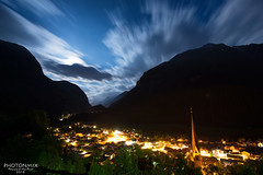 Oetz - Im Mondlicht (Andy Brandl (PhotonMix)) Tags: fullmoon landscape austria night longexposure mountains valley lights village oetz oetztal europe oesterreich tranquility quiet movingclouds kirchturm above