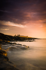 Golden Nuggets (ianbrodie1) Tags: northumberland portrait sea seascape rocks golden dunstanburghcastle castle dunstanburgh cloud sunrise moody coast coastline ocean leefilters lee filters