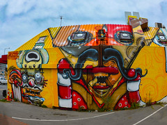 Do You Fancy A Mexican Meal? (Steve Taylor (Photography)) Tags: graffiti mural streetart building restaurant colourful man men newzealand nz southisland canterbury christchurch cbd city eyes moustache teeth face aerial jacob yikes dtr fat carpark ducting
