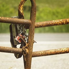 Not locked (steve.schlick) Tags: oshawa ontario canada farm windfields locks gate rust metal chain links green grass road concrete paint keepout