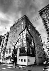Dark skies for a dark building (TokyoInPics) Tags: blackandwhite tokyo japan ebisu architecture building